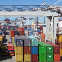 A photo of containers under a gantry crane in a container port - port of Leixoes - used in our How ports work logistics training